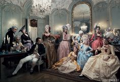 Louis XVI, played by Jason Schwartzman (at rear), and his wife (Dunst, in pale blue) hold court at a late-night gambling party. The queen\'s lover, Axel von Fersen (played by Jamie Dornan, front left), watches longingly from afar. Shot in Paris at the Centre Historique des Archives Nationales, Hôtel de Soubise—where many of the movie\'s interiors were filmed. The sumptuous costumes were created by Milena Canonero and the wigs by Rocchetti. Set design by Jean Hughes de Chatillon.-AT