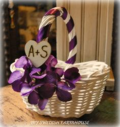 @Valerie Mendoza Guilbert  Flower Girl Basket Beach Rustic Wedding Decor Your Choice of Ribbon Paint and Flower Color. $32.00, via Etsy.