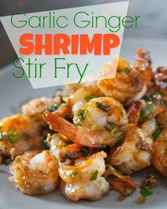 """Recipe: Garlic Ginger Shrimp Stir Fry Summary: Start to finish – 15 minutes. It's the easiest stir fry recipe and so tasty with soy sauce and oyster sauce together. The aromatics include the """"Chinese Trinity"""" – garlic, green onion and ginger. Wok Recipes, Garlic Recipes, Stir Fry Recipes, Kitchen Recipes, Seafood Recipes, Asian Recipes, Cooking Recipes, Healthy Recipes, Mexican Recipes"""