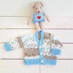 fe39cada38a Hand knit baby cardigan in soft shades of blues