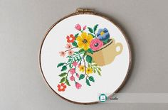 Mug with flowers cross stitch pattern. Information about pattern: Stitches: 94 W x 97 H Floss: DMC colors) Size: x cm/ x inch count) x cm/ x inch count) Embroidery hoop: Fits a 9 inch embroidery hoop (if stitched on 14 count Aida) Skill level : Easy Cross Stitch Heart, Cross Stitch Fabric, Simple Cross Stitch, Cross Stitching, Cross Stitch Embroidery, Pattern Floral, Bag Pattern Free, Types Of Stitches, Girls With Flowers