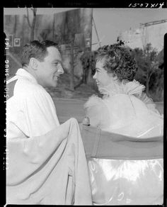 """Behind the scenes still of Gene Kelly & Leslie Caron on the set of """"An American in Paris"""" (1950)"""
