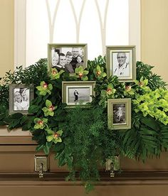 Casket Spray with pictures in arrangement This is a beautiful way to personalize a loved ones funeral service.