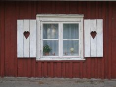 » Blog Archive » When One Door Closes…… Red Swedish cottage with heart shaped cutouts in wooden shutters