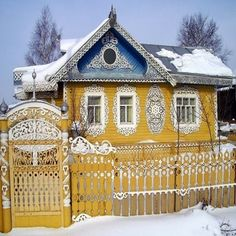Russian wooden house and a wooden fence in the town of Vologda.