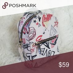 I just added this listing on Poshmark  NWT Faux Leather Graffiti Backpack.   shopmycloset  poshmark  fashion  shopping  style  forsale  Guess  Handbags 0e4d554f4a