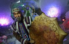 Vasily Atlasov in a Yakut national costume with an ethnic shaman drum in Dykhaniye Olympiadi [Breath of the Olympics] ice cave in Us-Kut, homestead of Atlasov family in Yakutsk, Russia.