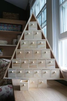 Behold, our 2011 Advent calendar project! :) Not to get ahead of myself - this being August and all - but I absolutely love the season of Advent! And I love to come up with new projects that highlight the. Wood Advent Calendar, Christmas Tree Advent Calendar, Advent Calenders, Diy Calendar, Wooden Christmas Trees, Printable Christmas Cards, Christmas Crafts, August Calendar, School Calendar