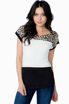 A casual colorblocked tee with a touch of wild! Leopard print chiffon panel at the shoulders. Round neck. Short sleeves. Finished hem. Lightweight knit.