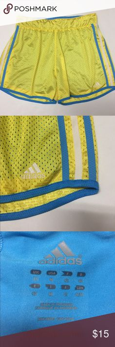 """Adidas Marathon 10 Women's Shorts Size Medium Mesh Pre-owned and in great condition! Not sure what it's from but on the front it has a few lines as if it was snagged, (see last photo) The outside is Mesh with blue lining on the inside.  NO pockets.     Waist(side to side) 15""""  Length(top to bottom) 14.5"""".   Bright yellow. Adidas Shorts"""