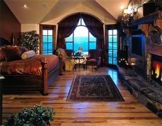 a huge master bedroom with a fire place