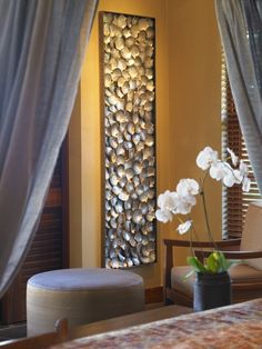 wall art with sea shells -- collect, glue into deep frame, and display by maura
