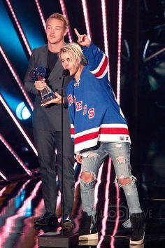 Justin Bieber wearing  Fear of God Military Sneakers, CCM Vintage Wayne Gretzky NHL New York Rangers Jersey, Fear of God 4th Collection Selvedge Denim Vintage Indigo Jean