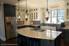 Now this is really similar to my dream kitchen! Love the Island stove and big windows. Look at all that counter space.