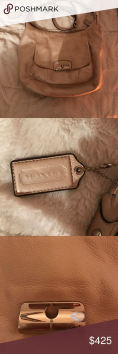 Authentic Coach Purse Gorgeous neutral beige color, genuine leather, authentic coach. Loved. A few pen spots/dark spots (seen in picture) which you can dry clean out. Strap to lengthen included. See matching wallet in my closet! Coach Bags