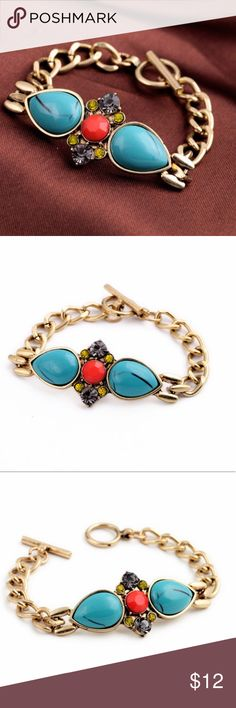 Turquoise Crystal Gold Chain Toggle Bracelet NWT Vintage look, gold bracelet with Turquoise and crystal accents. Bracelet is on a chunky gold chain, and has a toggle closure. One size fits all. Express Jewelry Bracelets