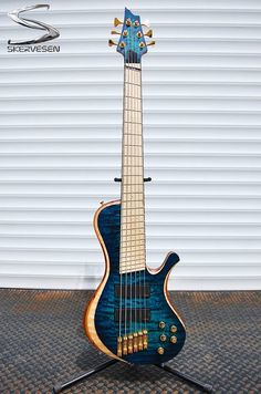 """Skervesen Prometheus 6 bass. 33-35"""" multiscale, Neck Thru Body construction, tuning B E A D G C. 7-piece maple/wenge/bubinga neck with flamed maple fretboard and ebony/maple binding. Walnut wings, bubinga middle layer, radius quilted maple top, rosewood insert on the back - we call it SOUL. EMG 45TW-X pickups"""