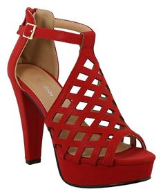 999dcdfc388a A dramatic heel lends a towering height boost to this peep-toe sandal  sporting a