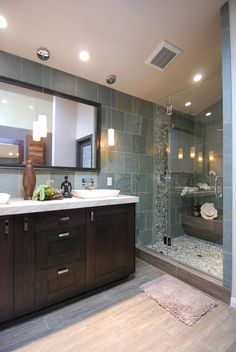 Green Pebble Tile Shower Pan & Accent Strip