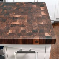 Changes Equal Big Improvements in a Kitchen Space Durable end-grain walnut butcher block by John Boos echoes new oak flooring stained to match.