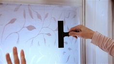 Adding window film will block out nosy neighbors while still allowing the light to shine through. Here, we show you how to get a smooth, bubble-free application.