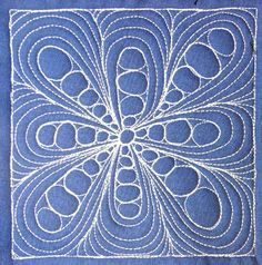 Pebble Daisy - This intermediate level free motion design isn't super difficult, but it does involve learning a series of steps that will really add to your quilting abilities. Learn these steps in the video at http://freemotionquilting.blogspot.com/2011/11/day-343-pebble-daisy.html