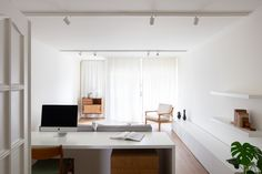 Carnide Apartment is a minimalist apartment located in Lisbon, Portugal, designed by Lola Cwikowski Minimalist Apartment, Minimalist Interior, Lisbon Apartment, Central Table, White Sideboard, Minimal Kitchen, Neutral Walls, Interior Minimalista, Kitchen