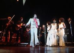 "Elvis during the filming of ""Elvis On Tour"" with members of the TCB Band, Kathy Westmoreland, The Sweet Inspirations and J.D. Sumner and the Stamps Quartet."