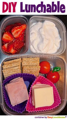 meat, cheese tomatoes, crackers with yogurt and fruit.