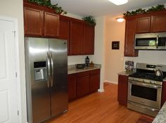 Craftsman Kitchen with flush light, Side by Side Refrigerator, Inset cabinets, partial backsplash, Simple granite counters