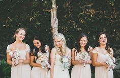 Bridesmaids in pink with sweet bouquets