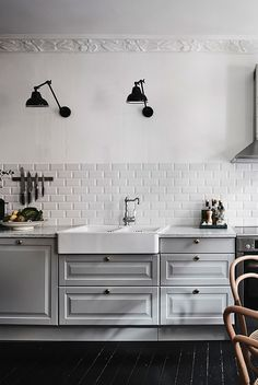 Living kitchen with strong black accents - via cocolapinedesign.com