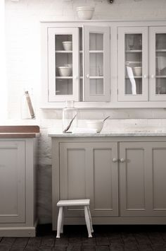 The Classic English Kitchen by deVOL...gray bottom cabinets white on top...white walls