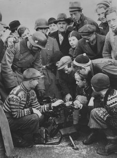 Wehrmacht soldiers with Norvegian civilians, 1940.