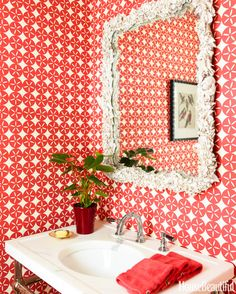 Go bold with wallpaper – especially in a small bathroom.