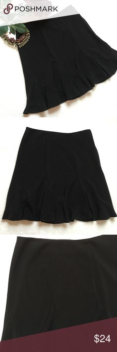 "{WHBM} Trumpet Pleated Skirt White House Black Market flirty black trumpet pleated skirt. Asymmetrical pleats with flare at bottom. Invisible side zip closure with hook and eye closure. 16"" flat across waist. 20"" long. 94% polyester 6% spandex. Excellent preloved condition. White House Black Market Skirts"