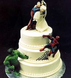 I like how these action figures are incorporated into the cake.  Also, it shows you don't need a super crazy cake, the action figures really dress it up!