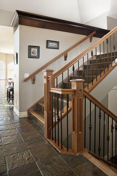 Best A Step Down Foyer Features A Staircase With Balusters Of 400 x 300