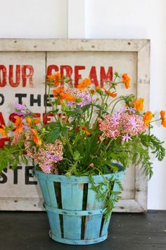 old advertising and painted baskets   The Polished Pebble   Ojai Cottage basket makeover