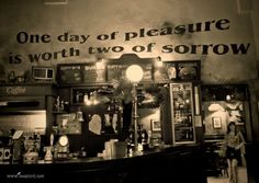 Travel Postcard - One day of pleasure is worth two of sorrow - Tags - travel, italy, sign, beabird, hangover, funny, bologna, pub - www.cardfed.com