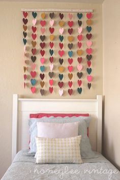 DIY Paper Heart Wall Art. Use sample paint color and use a heart punch out to create this. Dorm room