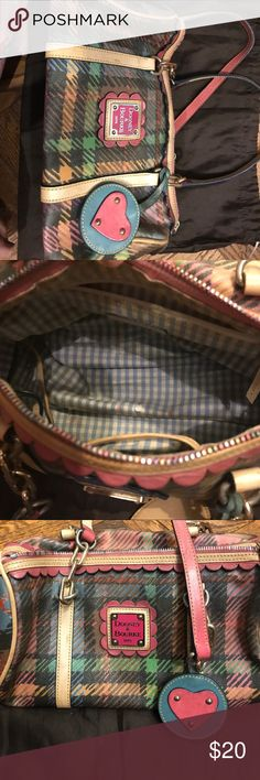 Dooney and Bourke Tartan Barrel Bag My first D & B bag and the most reliable! It is in a used condition with light stains on the inside.  This bag has a sturdy and durable outside, but needs some TLC. Dooney & Bourke Bags Shoulder Bags
