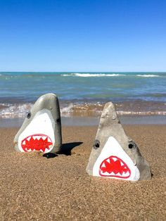 Wouldn't want to meet these two on the beach! Learn how to paint these vicious sharks on rocks. A fun summer craft idea for kids and adults!