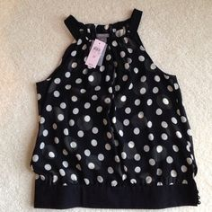 ‼️3XHOST PICK‼️Ann Taylor b&w polka dot halter Ann Taylor black and white polka dot halter top NWT. She'll 100% silk, lining 100% polyester. Fabulous under a blazer or alone while out and about. Downtown Romantic Party Host Pick 1/28/15, Romantic Style Host Pick 3/1/15, Polished and Preppy Host Pick 4/15/15. Ann Taylor Tops