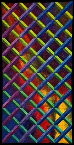 """Lattice Works VI"" by Carol Olsen, an experiment in making 2D look 3D.  The lattice is done in an analogous green-blue-violet color scheme.  underlying squares move from dark to light, creating luminosity"