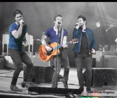 Hunter Hayes with Dan & Shay on stage - credit to Alexandra Wright for edit
