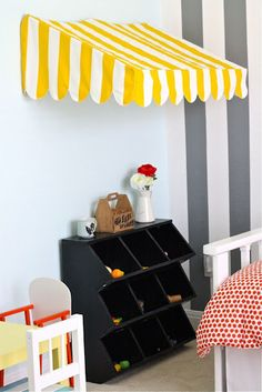 Bistro Awning Mini-Tutorial... Love the bins for toys