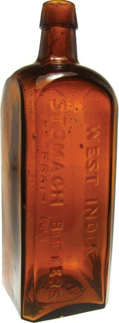 West India Stomach Bitters, St Louis MO, Square, Amber. A West India Stomach Bitters glass bitters bottle in amber marked St Louis MO on reverse