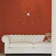 Exemplary designer high-end modern luxurious wall mounted analog clock finished in chrome and steel.