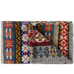 Established in the early 1890's, family owned business Jamieson's have been knitting jumpers in the wilderness of the Shetland Islands for over 120years. Their legacy in producing quality local fabrics still carries on today, this Fair Isle scarf is the perfect combination of luxury and comfort in an iconic design.  100% Pure New Wool Fair Isle Design Made in the Shetland Islands, Scotland